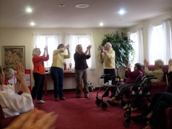 Daval Hospice Group Does a Laughter Yoga Session